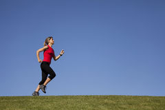 Running at the top of the hill Royalty Free Stock Images