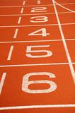 Running Track. White number markings on a running track royalty free stock image