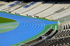 Running track. Close up of a blue running track in a stadium stock images