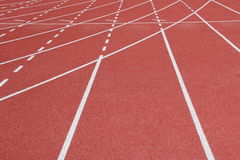 Running track. Runway with crossed white lines. athletic plastic run track in stadium Stock Photography