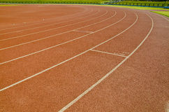 Running Track. Hard surface running track showing stoppers for relay race Stock Photo