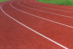 Running track. Curve of an oval running track royalty free stock photo