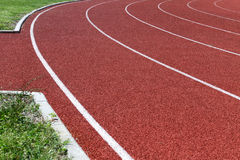 Running track. Curve of an oval running track royalty free stock images