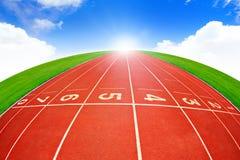 Running track. Over blue sky Stock Photos