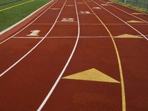 Running Track. Low angle image of an outdoor running track with numbered lanes and starting blocks Stock Image