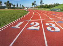 Running Track. Running rack showing the 1, 2 and 3 lanes at the starting line stock photos