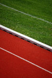 Running Track. And soccer field detail Royalty Free Stock Photos