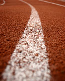 Running track. Rounding the bend on a track Royalty Free Stock Images