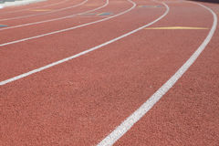 Running Track. Olympic track race lines with markings for races Royalty Free Stock Photography