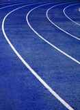 Running Track Blue. Lanes of blue running race track with curve at the end stock photo