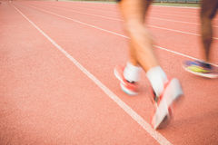 Running track with blur of runner feet in stadium Royalty Free Stock Photos