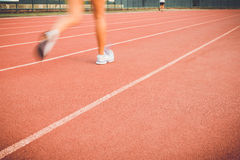 Running track with blur of runner feet in stadium Royalty Free Stock Image