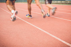 Running track with blur of runner feet in stadium Royalty Free Stock Photography