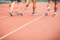 Running track with blur of runner feet in stadium Stock Image