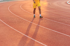 Running track with blur of runner feet in stadium Stock Images