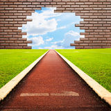 Running track through brick with one lanes to sky Royalty Free Stock Images