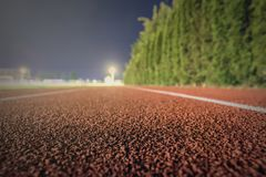 Running track close up. Night time shallow depth of field. Sport. Background. Sport Background Stock Photos