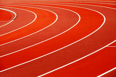 Running track. Close-up of red running track with lines royalty free stock photo