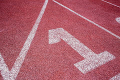 Running track closeup at first place 1 lane. Royalty Free Stock Images