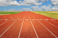 Running Track with Clouds Stock Photo