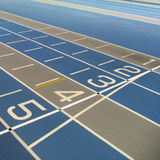 Running track finish line. Indoor running track start/finish line - great concept stock images