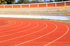 Running track and grandstand in stadium Stock Images