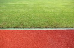 Running Track And Green Field. Abstract View Of Running Track And Green Field Royalty Free Stock Photos