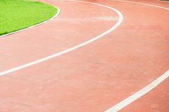 Running track and green field in sport park Royalty Free Stock Photos