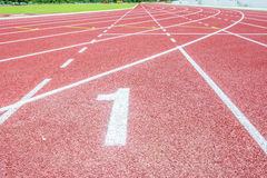 Running track and green grass Royalty Free Stock Image