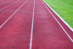 Running track and green grass,Direct athletics Running track Stock Images