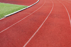 Running track and green grass,Direct athletics Running track Royalty Free Stock Photo