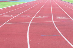 Running track and green grass,Direct athletics Running track Royalty Free Stock Photography