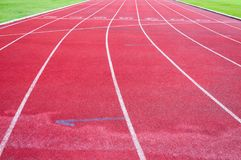 Running track and green grass,Direct athletics Running track at Sport Stadium. Running track and green grass,Direct athletics Running track at the Sport Stadium royalty free stock photo
