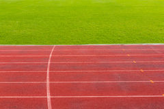 Running track with green grass Stock Photography