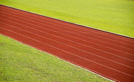 Running Track and green grass  At  Sport Stadium Stock Image