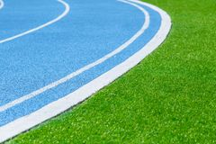 Running Track with Green Grass stock image