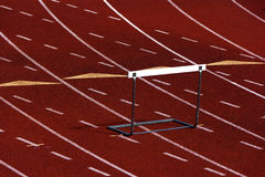 Running track with a hurdle Stock Photography