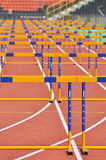 Running track with hurdles in perspective Stock Photography
