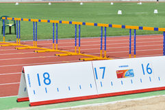 Running track with hurdles and a ruler Royalty Free Stock Photography