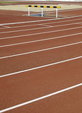 Running track, jumping. A fence detail on the track Stock Image