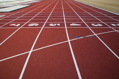 Running track. Lanes of a red race track with numbers stock photography