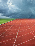 Running track leading to storm Royalty Free Stock Images