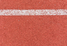 Running track line. White line on red asphalt running track Stock Images