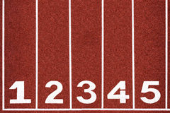 Running track with number 1-5, abstract, texture, background. Royalty Free Stock Images
