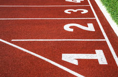 Running track with number 1-4, abstract, texture, background. Royalty Free Stock Photography