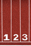 Running track with number 1-3, abstract, texture, background. Royalty Free Stock Photography