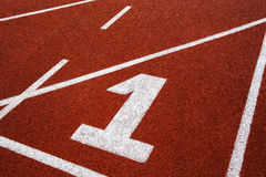 Running track with number 1, abstract, texture, background. Royalty Free Stock Images
