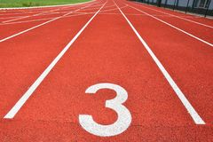 Running track with number 3. Colorful background for sport. Stock Photo