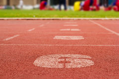 Running track and number lanes Royalty Free Stock Images
