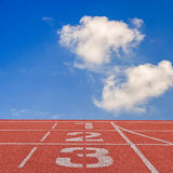 Running track number standard red color under the blue sky. Stock Photo
